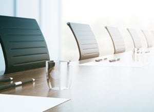 concept image of a conference table with chairs