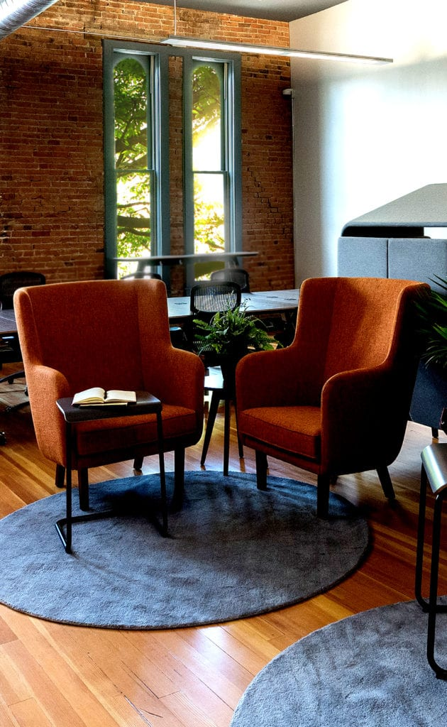 orange chairs in an informal meeting space on Broadway