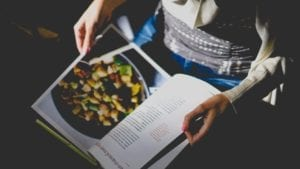 person holding a cookbook